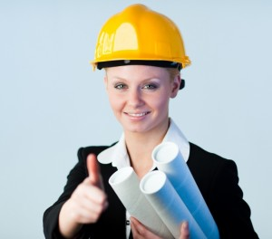 3678966-female-constrcution-worker-with-blueprints